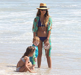 Jessica Alba wore a purple bikini in Malibu while hanging out with her daughters in Sept. 2013.
