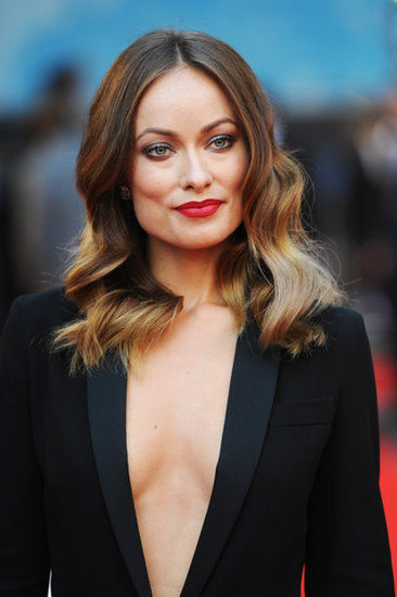 Olivia Wilde showcased a plunging neckline at the world premiere of Rush.