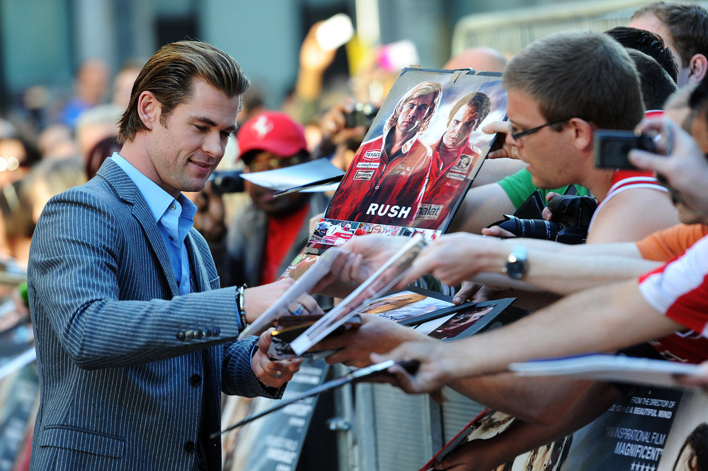 Chris Hemsworth signed autographs at the Rush premiere.