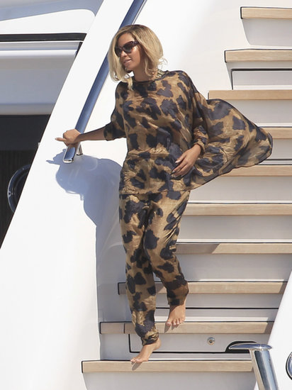 Beyoncé was undeniably glamorous in a leopard-print look consisting of a flowy top and matching pants while vacationing on a yacht in Formentera, Spain. The singer added further dramatic effect via exaggerated cat-eye sunglasses.