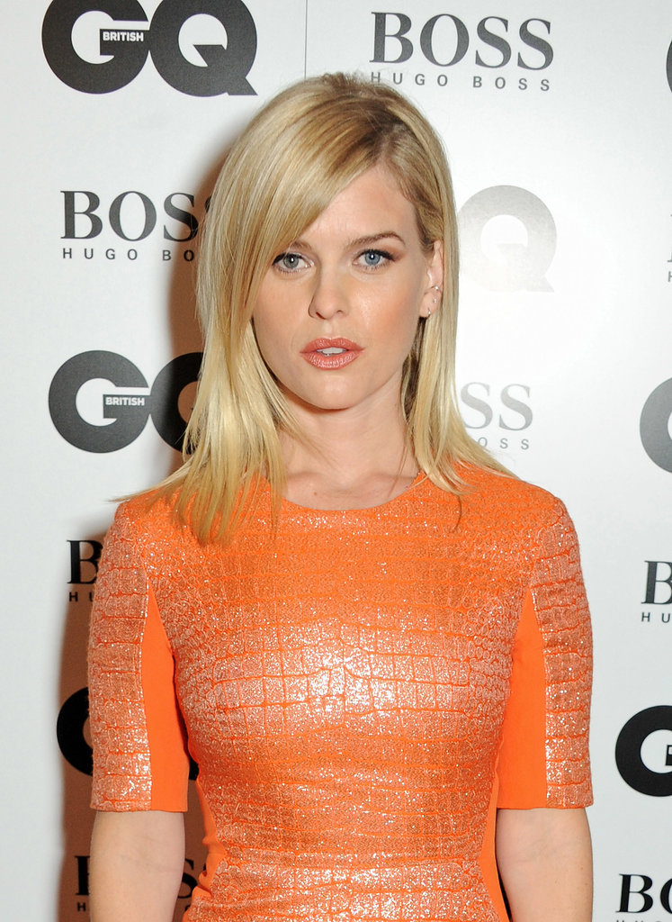 Alice Eve matched her peachy lipstick with her orange frock, and paired the colorful look with a simple blowout.