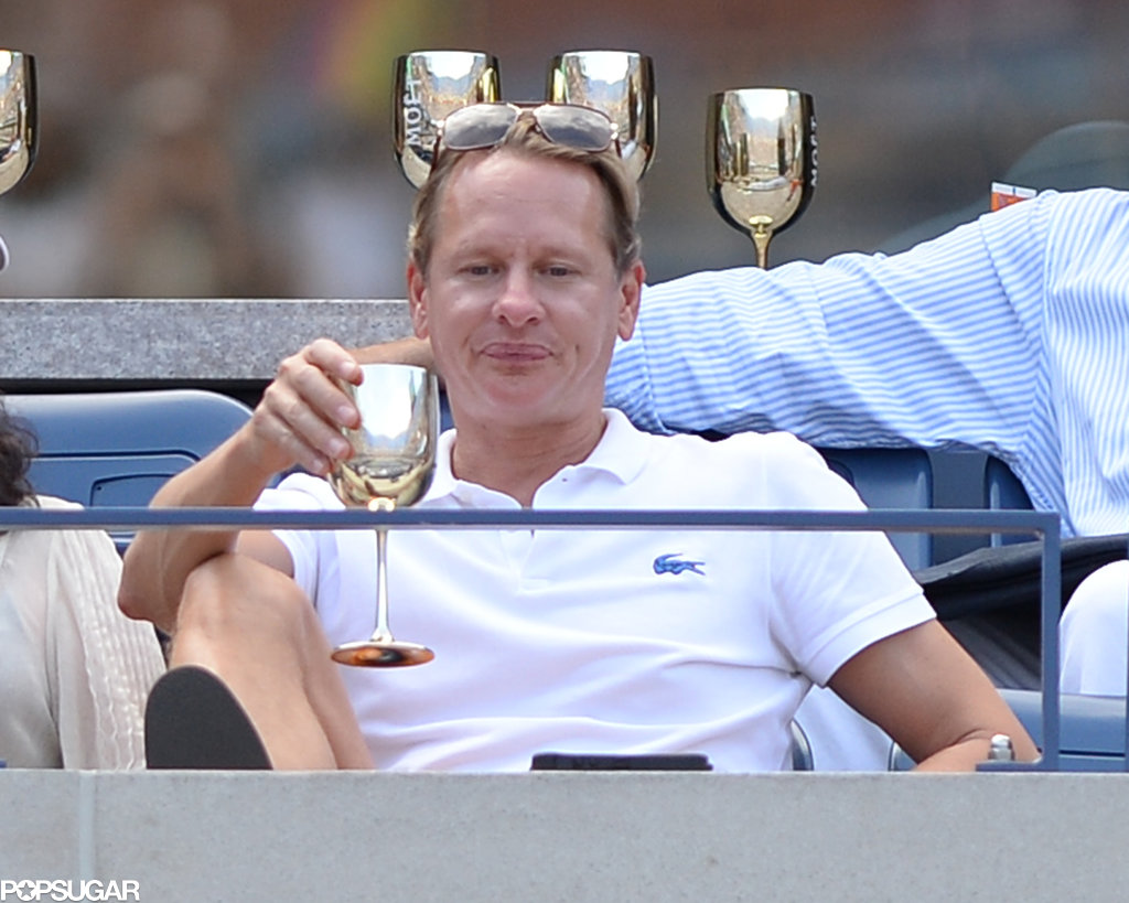 Carson Kressley sipped a beverage from a silver cup.