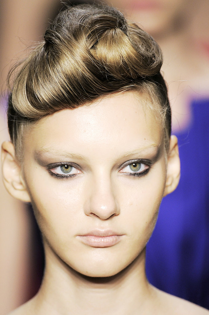 Andrew Gn's Spring/Summer 2010 models had voluminous victory rolled fringes and smoky flicked liner.