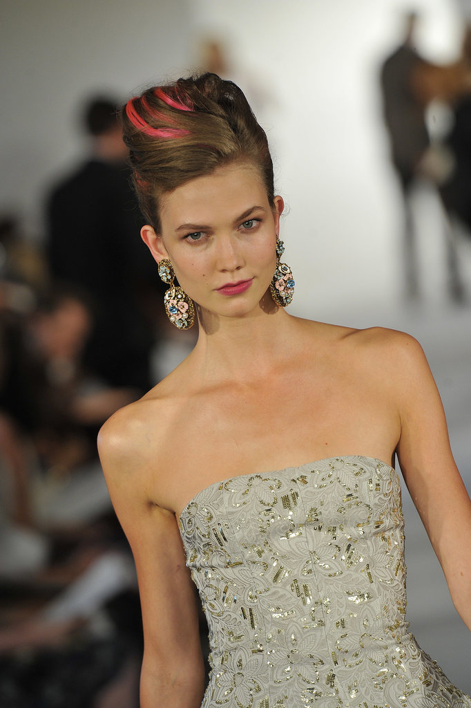 At Oscar de la Renta's Spring 2013 show, a flash of print brightened up a sleek beehive updo.