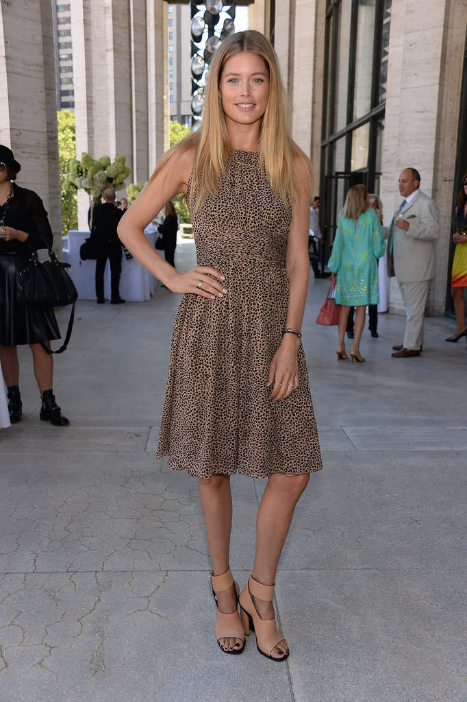 Also at the 2013 Couture Council Fashion Visionary Awards in NYC, Doutzen Kroes coordinated her printed knee-length Michael Kors dress with tan ankle-strap sandals.