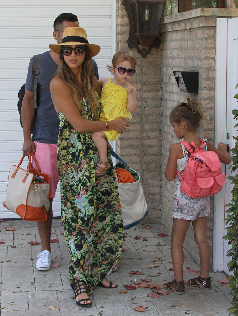En route to a Labor Day party in Malibu, CA, Jessica worked a printed maxi dress with a panama hat and black sandals.