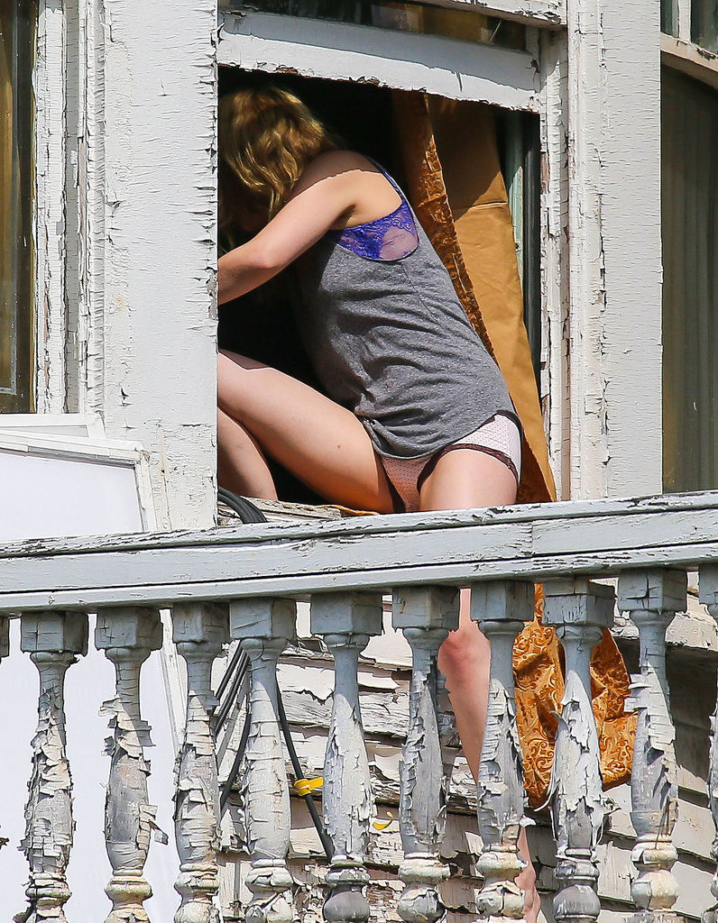 Dakota Johnson popped back inside during a shoot on the set of Cymbeline.
