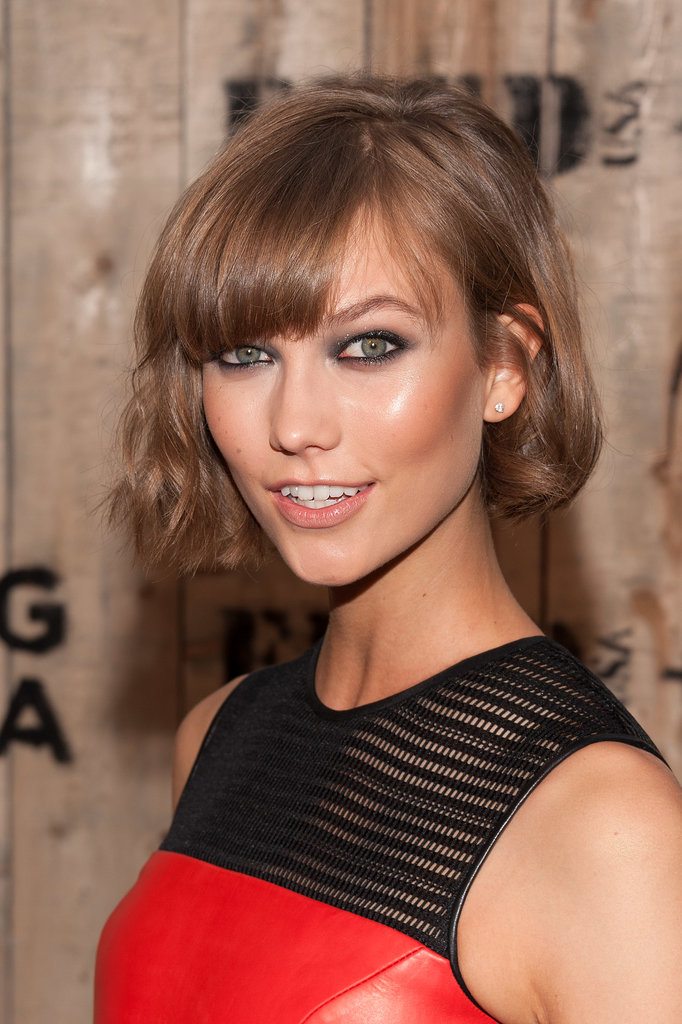 After being one of the first ladies to lob off her hair just about a year ago, Karlie has kept cutting at her length. We're loving this recently asymmetrical take on her hair, which is a little longer on one side than it is on the other.