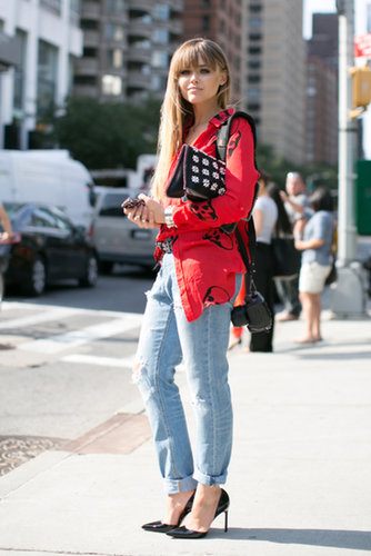She gave jeans a jolt with an edgy button-down and an embellished clutch in hand.