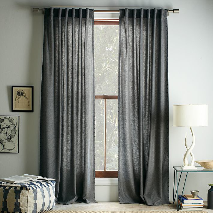 Dramatic curtains create a stunning impact, and these studded wool ones ($63-$87, originally $79-$109) fit the bill perfectly.