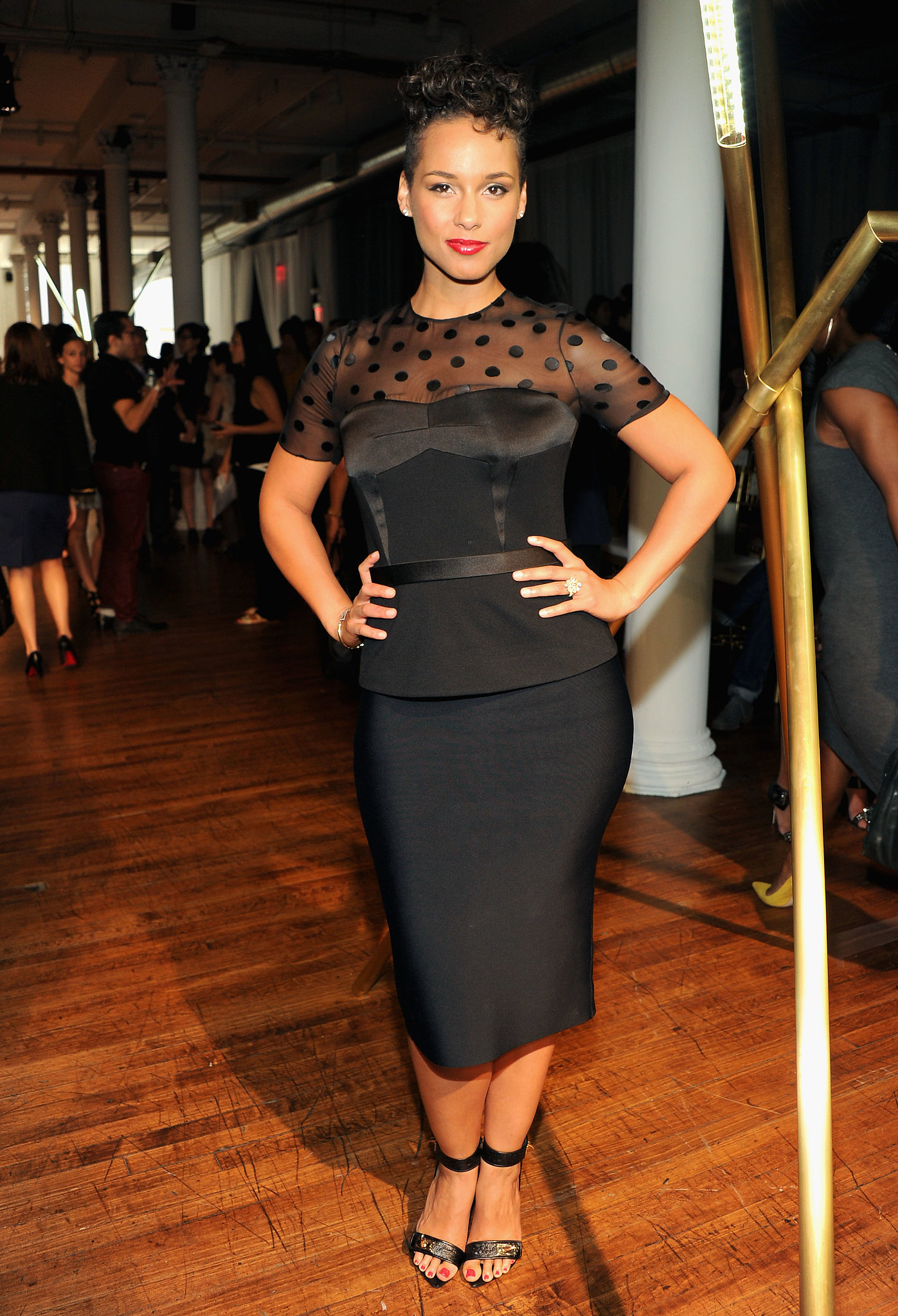 Alicia Keys got sophisticated in a black peplum ensemble featuring polka dots at the Jason Wu show at New York Fashion Week.