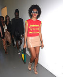 Solange Knowles arrived to Alexander Wang in a bright red-and-yellow graphic top, which she tempered with a nude leather skirt. But we can't forget about the accessories! Get a load of her sunglasses and shoes.