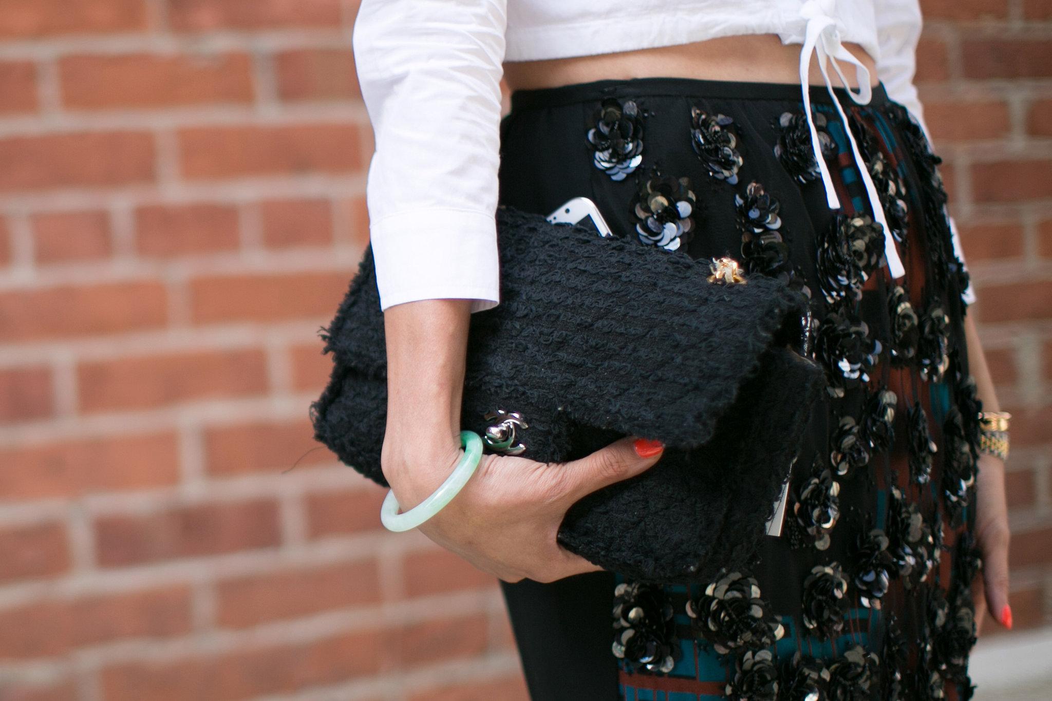 Eva Chen held her enviable Chanel tight.