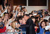 Hugh stopped to greet adoring fans.