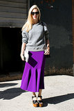 Joanna Hillman went sporty-meets-polished in a sweatshirt and flared skirt.
