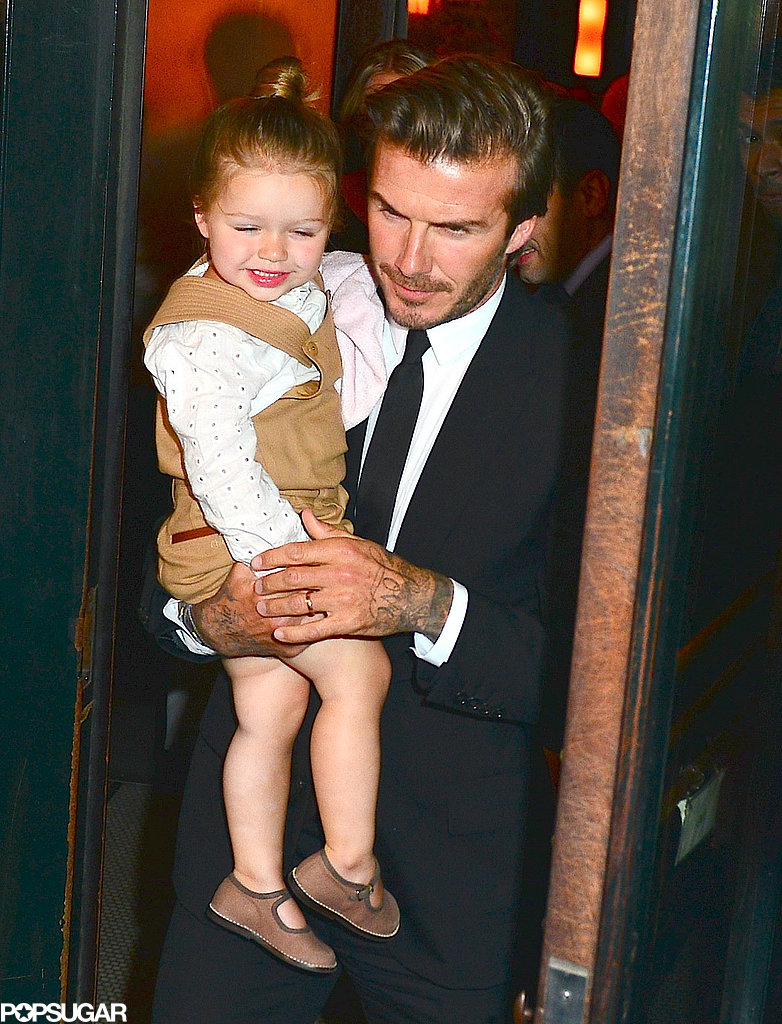David Beckham carried baby Harper out of Balthazar Restaurant in NYC.