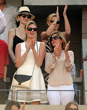 Kate Upton cheered on the tennis players at the US Open wearing a darling little white dress with an embellished hemline.