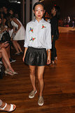 Tomoko Ogura arrived for the Yigal Azrouël runway show in a floral button-down and leather shorts.