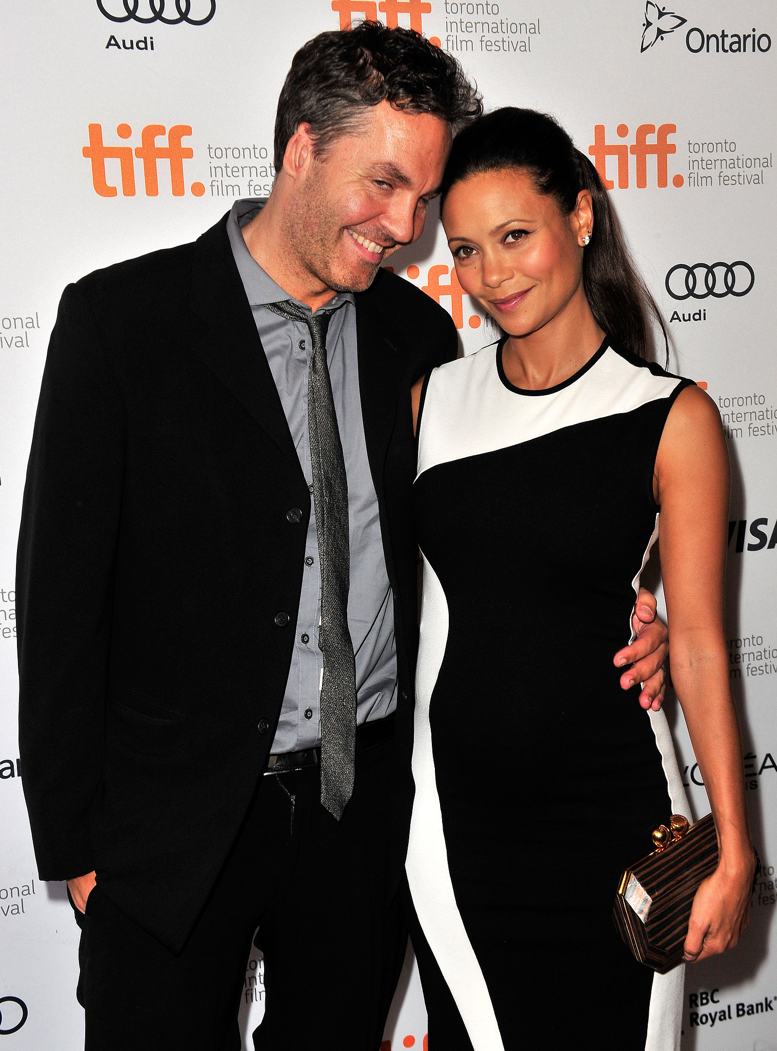 Thandie Newton cozied up to her husband, Ol Parker, after announcing her third pregnancy at the Half of a Yellow Sun premiere.