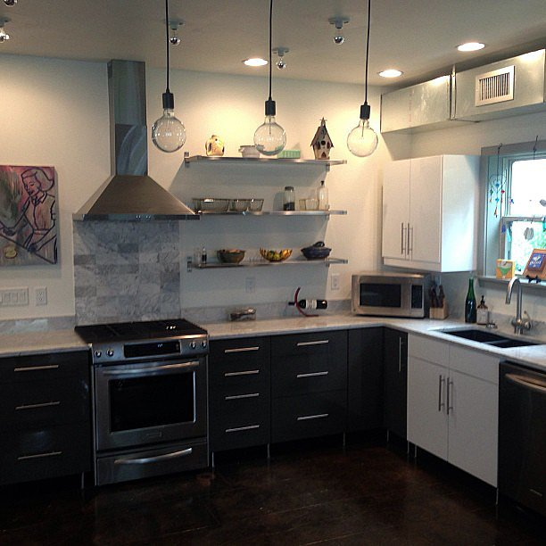 Instead of continuing your backsplash, consider designating it to just the stove and hood.  Source: Instagram user mr_reddenim
