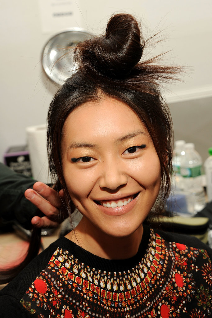Top knot and peek-a-boo eyeliner at Derek Lam.