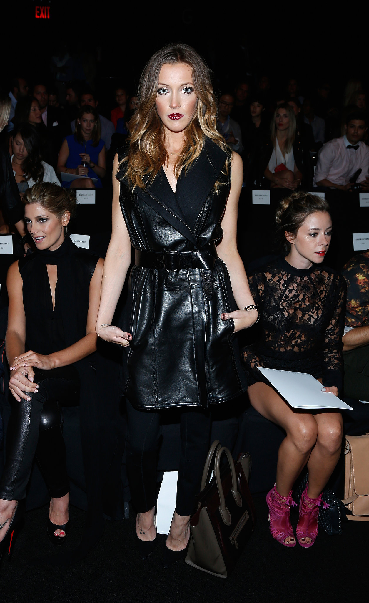 Katie Cassidy went for a dramatic vamp look in a slick black leather vest at Kaufmanfranco.