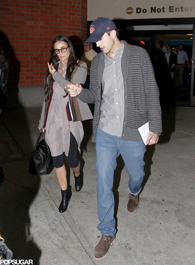 Ashton Kutcher and his ex-wife, Demi Moore, made their way through LAX together.