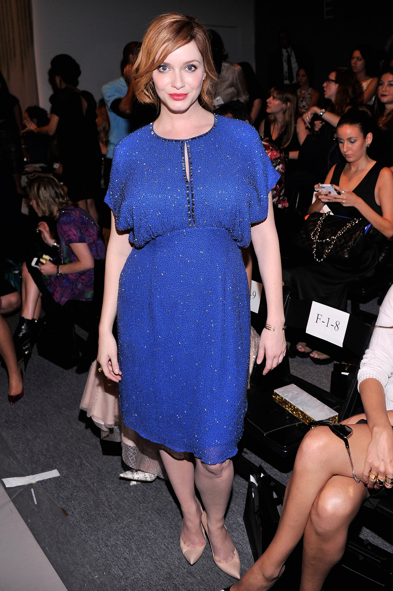 Christina Hendricks dazzled in an electric blue embellished dress at the Jenny Packham show.