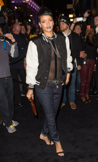 Rihanna wore a see-through shirt and jeans.