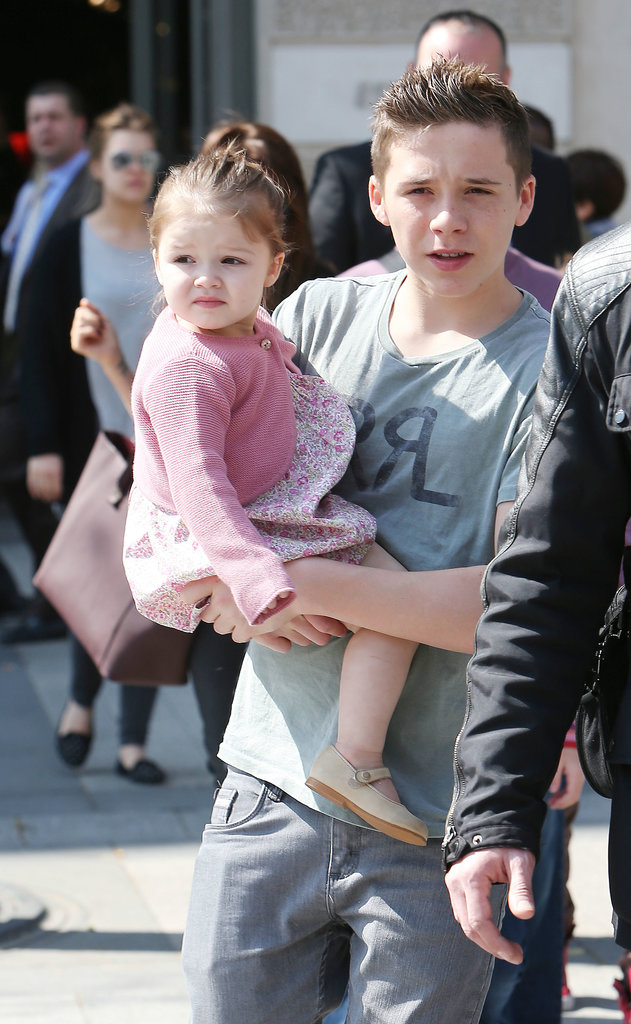 Brooklyn Beckham gave a helping hip to a curious Harper during a family trip to Paris.