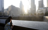 A woman became emotional while standing beside the 9/11 Memorial in NYC.