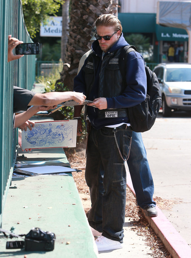 Charlie Hunnam signed autographs for fans.