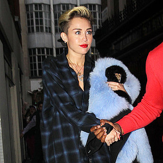 Miley Cyrus Wearing Thigh High Boots in London Pictures