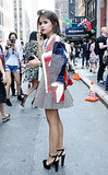 Miroslava Duma looked polished and flirty in mixed prints and a red lip.