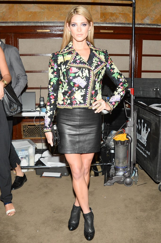 Ashley Greene's colorful embroidered Marchesa Voyage biker jacket lent major pizzazz to her leather skirt and booties at Marchesa's Spring 2014 show.