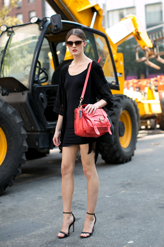 We have a serious crush on her candy-apple-red Proenza bag.
