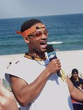 Will Smith sported an orange visor and glasses while on TRL in 2002.