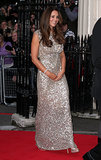 Kate's first postbaby red carpet appearance was nothing short of glamorous. Her shimmering pale gold gown was expertly accessorized by equally sparkling accessories: strappy sandals and a bejeweled bracelet.