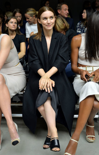 Rooney Mara took a darker approach while sitting front row at Calvin Klein Collection. She paired an oversize black collared coat with a silky skirt, then finished with strappy sandals.