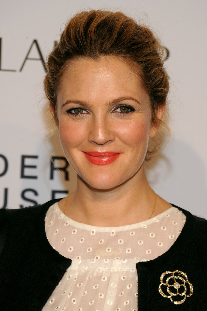 Drew Barrymore nabbed inspiration straight from the runway by donning Spring's hottest lipstick hue: orange. Rosy cheeks and a mussy updo finished the look.