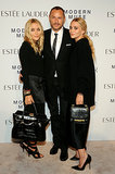 At the Estée Lauder party, Tom Pecheux squeezed between Mary-Kate and Ashley Olsen (and of course, their The Row bags!).
