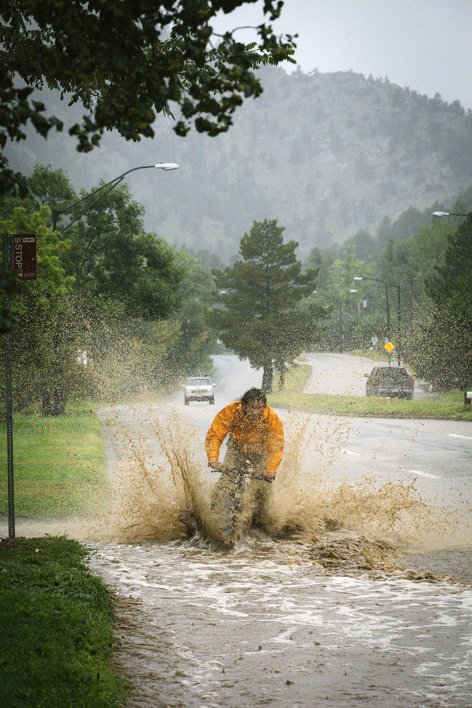 A biker splashed through the street in Boulder, CO.