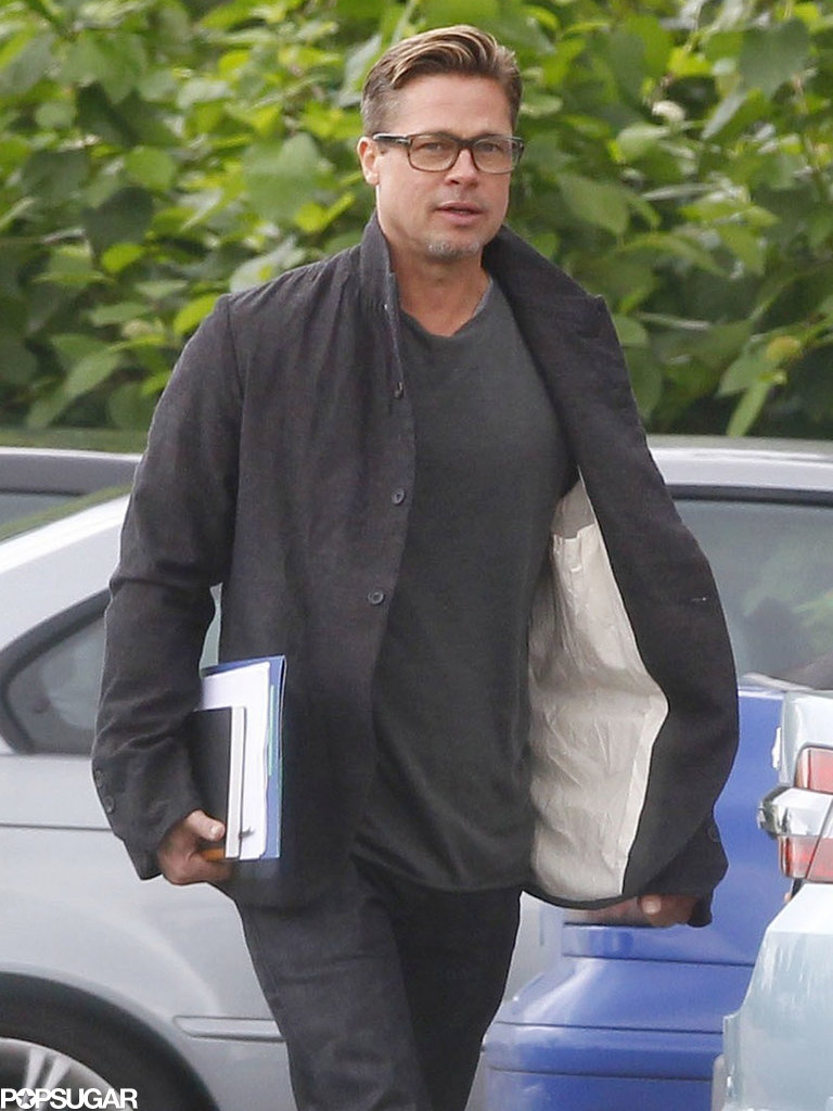 Brad Pitt debuted his new and improved haircut at the UK film set of his newest project, Fury.