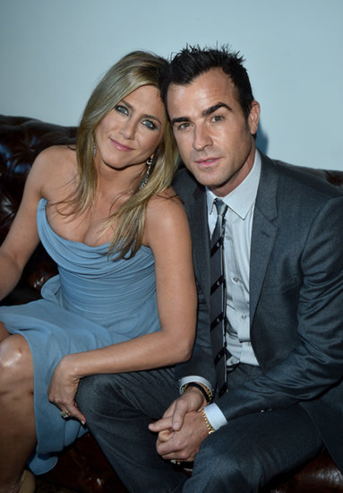 Jennifer Aniston cozied up to her fiancé, Justin Theroux, at a party to celebrate her new film in Canada on Monday.