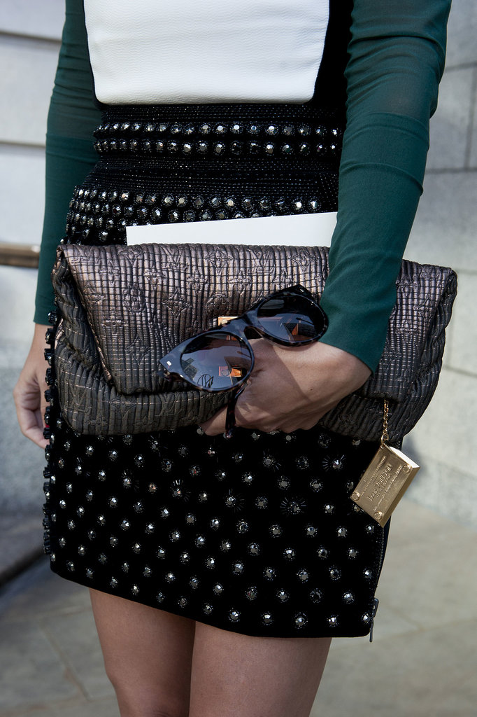 A little metallic Louis Vuitton to complement her sequined mini.