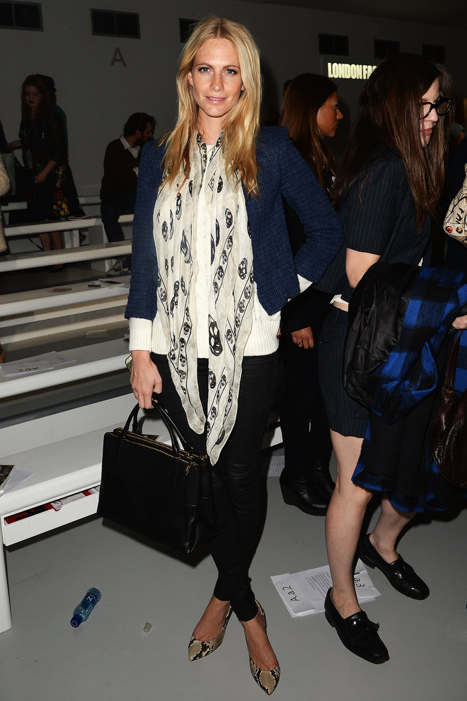 At the Simone Rocha show, Poppy Delevingne stuck to basics, then amped things up via a skull scarf and snakeskin pumps.