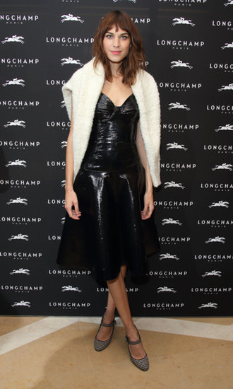 Also at the Longchamp party, Alexa Chung was slick in a black leather dress, which she cozied up with a fuzzy sweater.