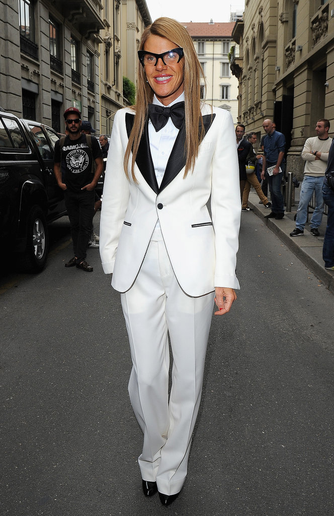 Anna Dello Russo borrowed from the boys in a white tuxedo outside Gucci's Spring runway show.