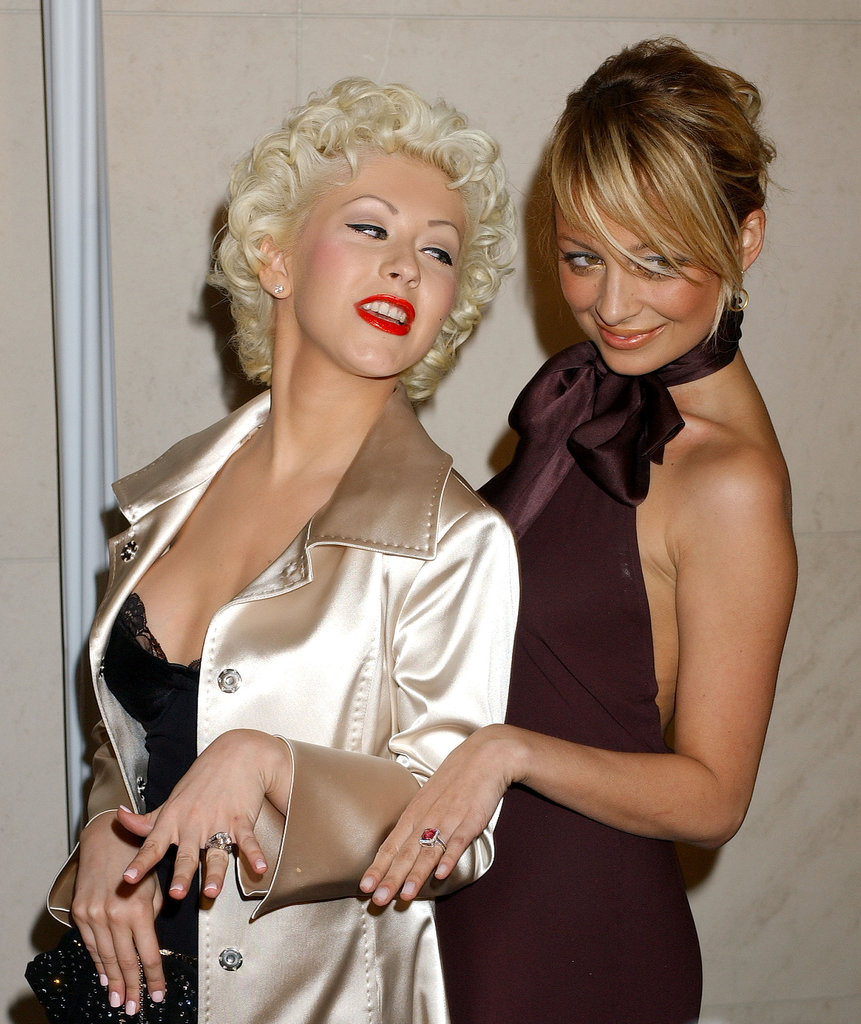 Nicole Richie and Christina Aguilera showed off their shiny new engagement rings — courtesy of DJ AM and Jordan Bratman, respectively — at a Roberto Cavalli store opening in LA in February 2005.