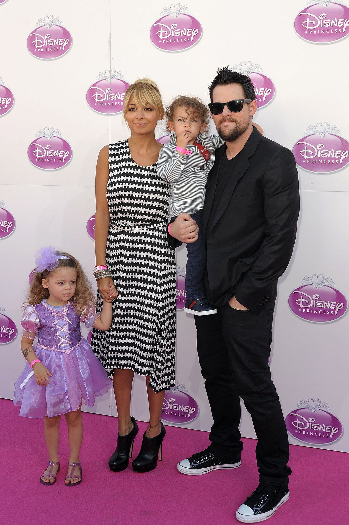 Nicole Richie and Joel Madden spent a fun family day with their little ones, Harlow and Sparrow, at a Disney event in London during October 2011.